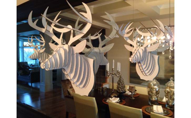 white stag heads with light